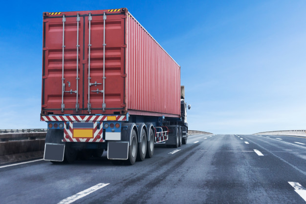 truck-highway-road-with-red-container-logistic-transport-asphalt-expressway_42493-37